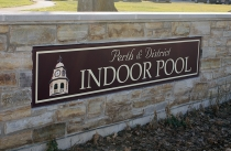 Pool Sign in stone wall